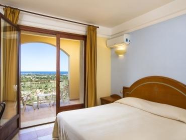 Camera in bilocale Residence Sud Sardegna